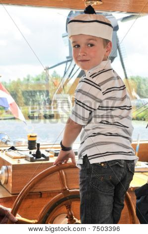 Captain On A Boat