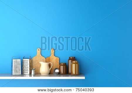 Shelf in kitchen with cutting boards and kitchenware on a blue wall (3D Rendering)