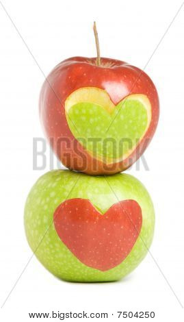 Two apples with heart silhouette