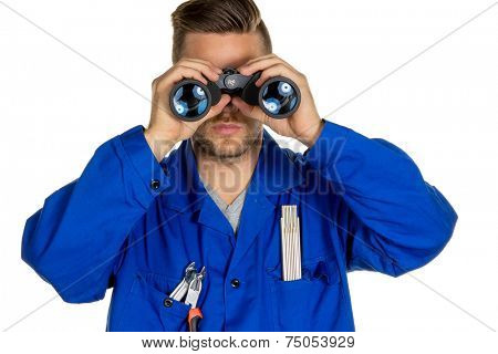 a worker in a trade or business (craftsmen) with binoculars in search of jobs or jobs