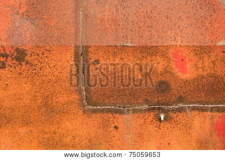 The side of a rusted grain cart shows the wear and tear of many years of work poster