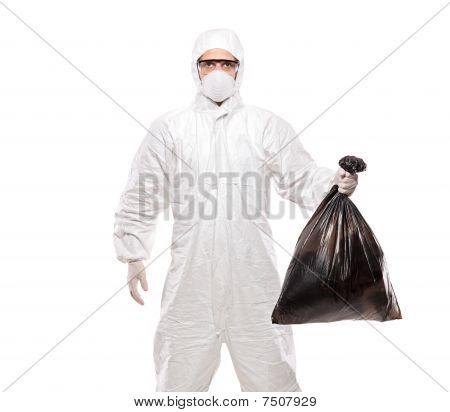 A man in uniform holding a black garbage bag