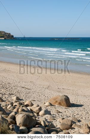 Sennen Cove Beach With Longships Lighthouse On The Horizon, Cornwall, Uk