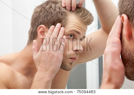 Handsome Young Man Worried About Hairloss