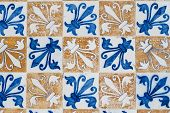 Detail of white, blue and brown Portuguese glazed tiles. poster