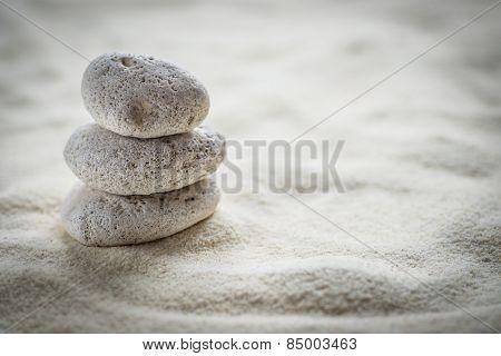 zen stones on the sand background