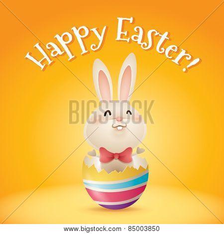 Happy Easter! Easter bunny inside a cracked easter egg.