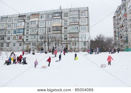 Children Are Sleding From The Hill