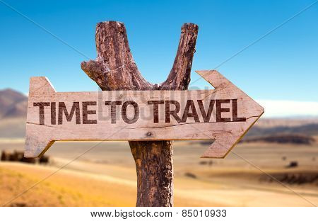 Time to Travel wooden sign with a desert background