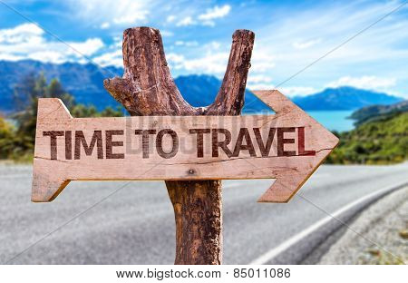 Time to Travel wooden sign with road background