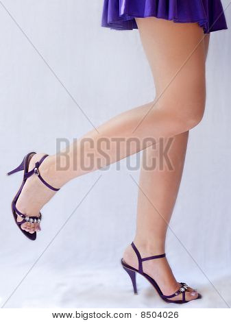 Smooth, sexy legs of a woman in high heels poster