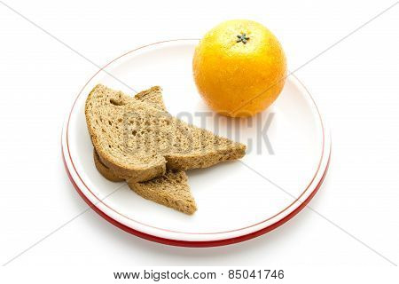 Fresh Brown Toast Bread with Orange on Plate