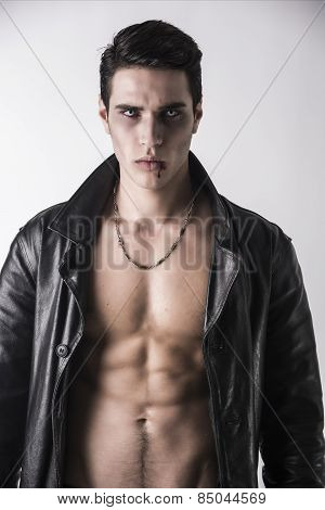 Young Vampire Man In An Open Black Leather Jacket, Showing His Chest And Abs