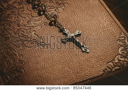 Rosary beads with bible in the shadow