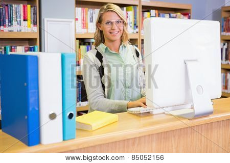 Pretty librarian working in the library at the university