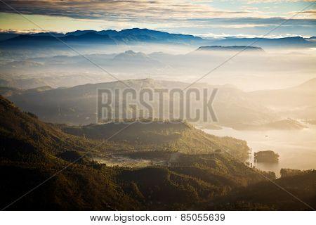 Amazing sunrise seen from Adam's Peak - sacred buddhist place. Sri Lanka poster