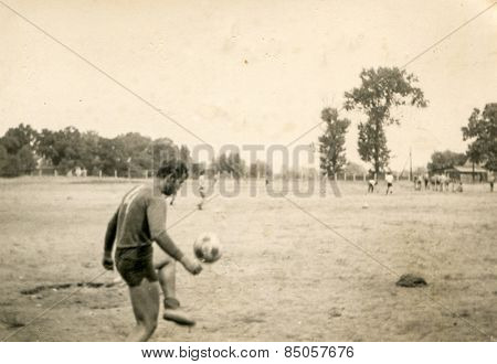Vintage photo of young man playing football (1960's)