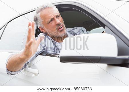 Man experiencing road rage in his car