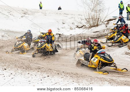 Snowmobiles moves on bend of sport track