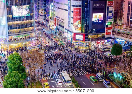 TOKYO, JAPAN - DECEMBER 23, 2012: Pedestrians cross at Shibuya Crossing. It is one of the world's most famous scramble crosswalks.