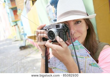 Tourist taking picutre in La Boca neighborhood, Buenos Aires