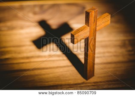 Overhead of crucifix icon on wooden table