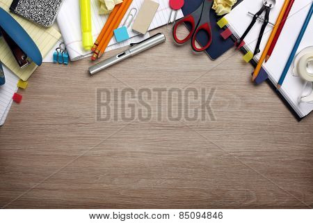 Desk cluttered with office supplies