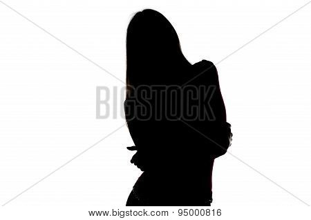 Silhouette of young woman with leaning head