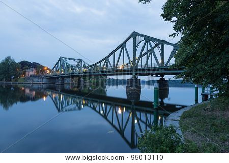 Glienicke Bridge is reflected in the Havel in Potsdam poster