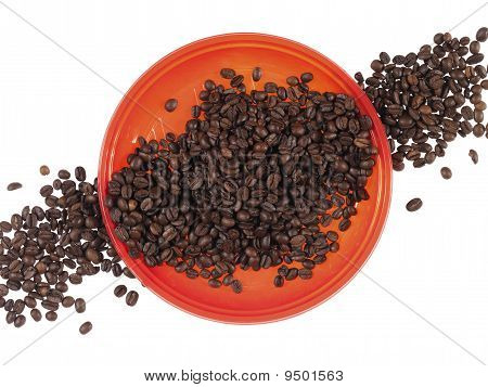 red dish full of coffee beans