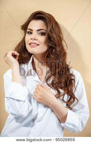 Pretty young girl in modern white blouse