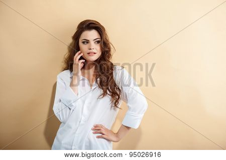 Pretty young woman is waiting for someone with desire