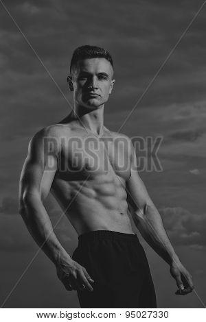 Sexy Bodybuilder On Sky Background
