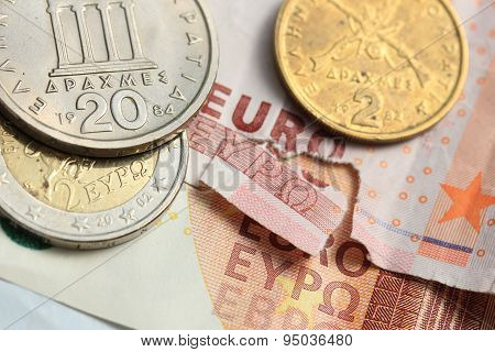 Torn Euro Note And Vintage Greek Coins