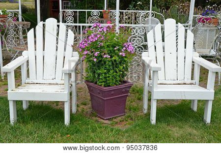 Two Old White Garden Chairs