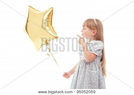 Pretty girl pointing balloon