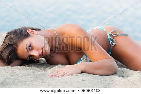 Beautiful Sexy Woman Lying On The Sandy Beach At Summer