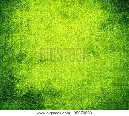 Grunge background of bitter lime leather texture