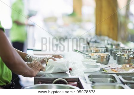 Wrapping Sandwich In Salad Bar Preparation Counter