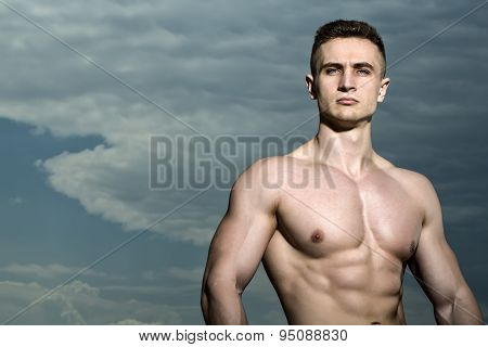 Muscular Bodybuilder On Blue Sky Background