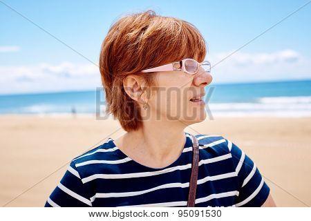 Stylish woman on the beach