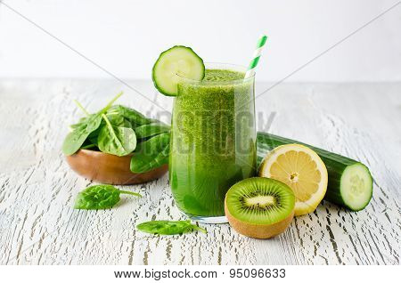 Green fresh healthy detox smoothie with spinach, cucmber, kiwi. Vitamin drink