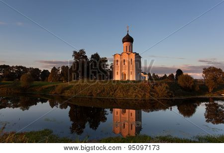 Church Of The Intercession Of The Holy Virgin On The Nerl River Lit With The Sun On A Sunset In Autu