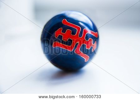 China Black ball with Red Symbol. Red Pattern on the Ball.