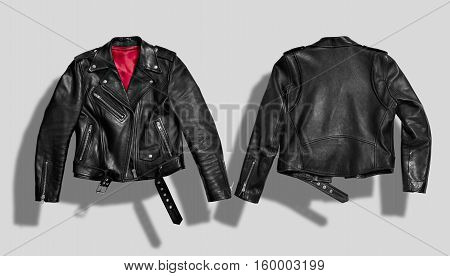 Classic black leather bikers' jacket with silk red lining shot from the front and the back isolated on white