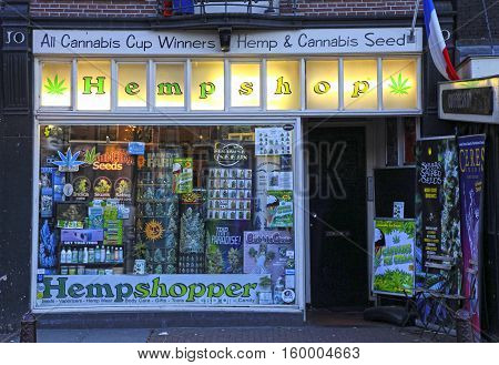 AMSTERDAM, NETHERLANDS - MAY 3, 2016: Showcase of cannabis shop located in old center of Amsterdam, Netherlands