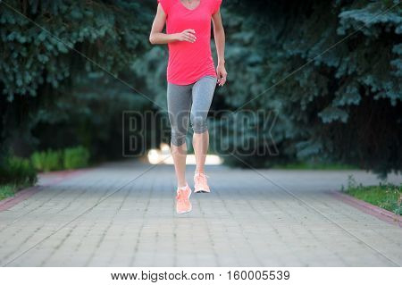 woman doing sport exercise at park. fitness woman stretches during training workout outdoor