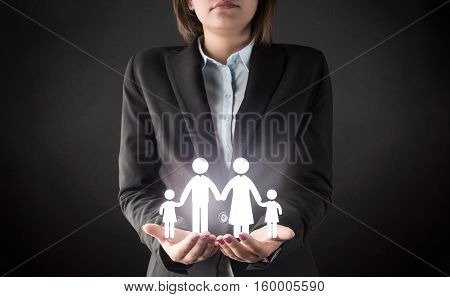 Business Woman protecting family concept high quality and high resolution studio shoot