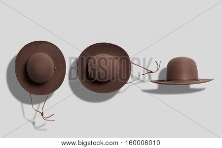 Coffee brown round felt cowboy hat with brown leather string shot from the top and from the side on white background