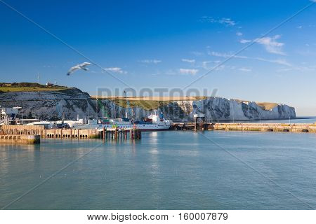 DoverEngland-July 92013: White cliffs and Dover harbor along the coast of English channel.The Port of Dover is the nearest English port to France at just 34 kilometres (21 mi) away.